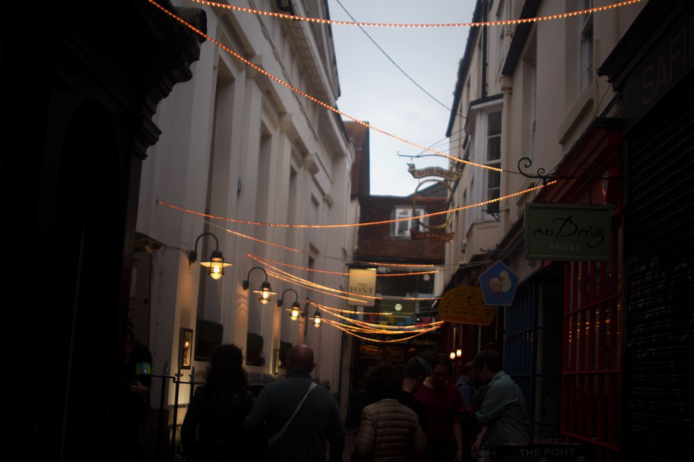 strings of lights hanging across one of the narrow streets in Brighton