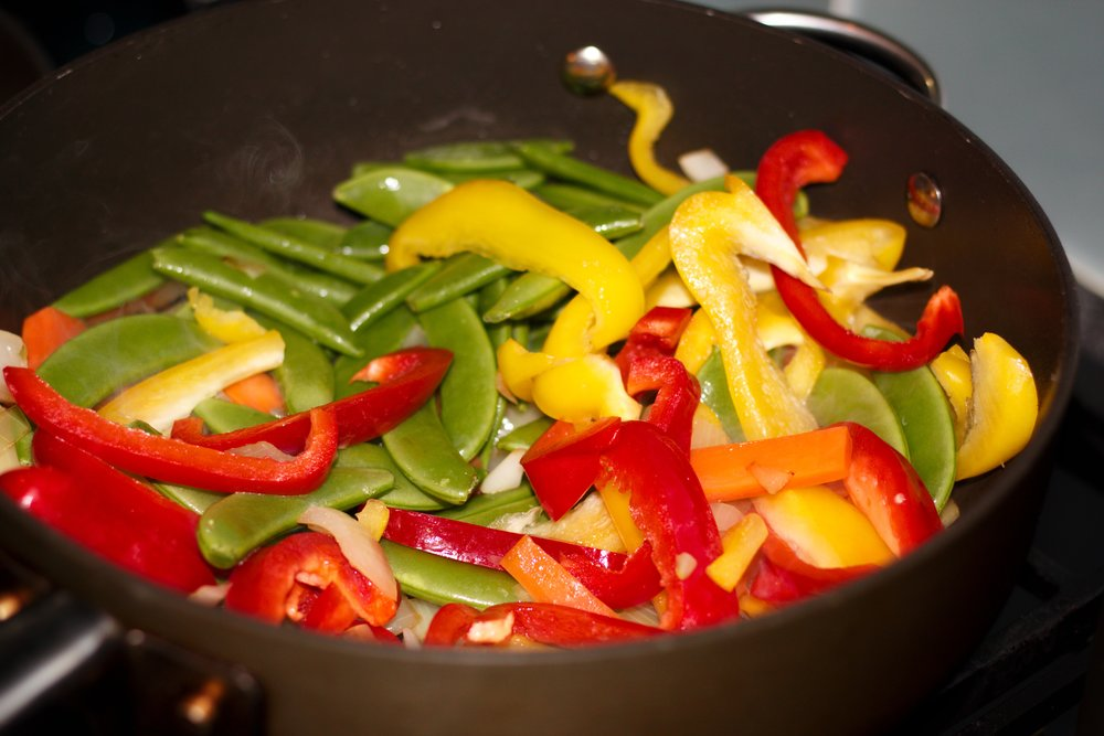 step 2: add the peppers and sugar snaps
