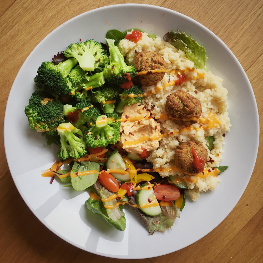 vegan buddha bowl with broccoli, falafel and couscous