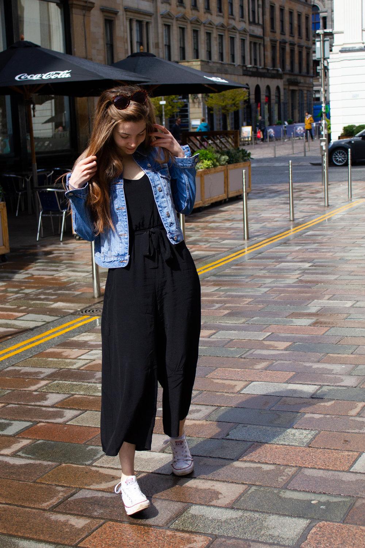 black jumpsuit and denim jacket