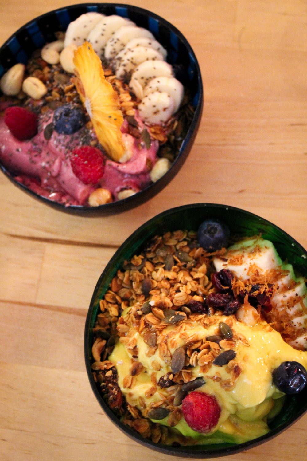 dragon fruit (top left) and Indian lassy (bottom right) smoothie bowls at Eat My Trip