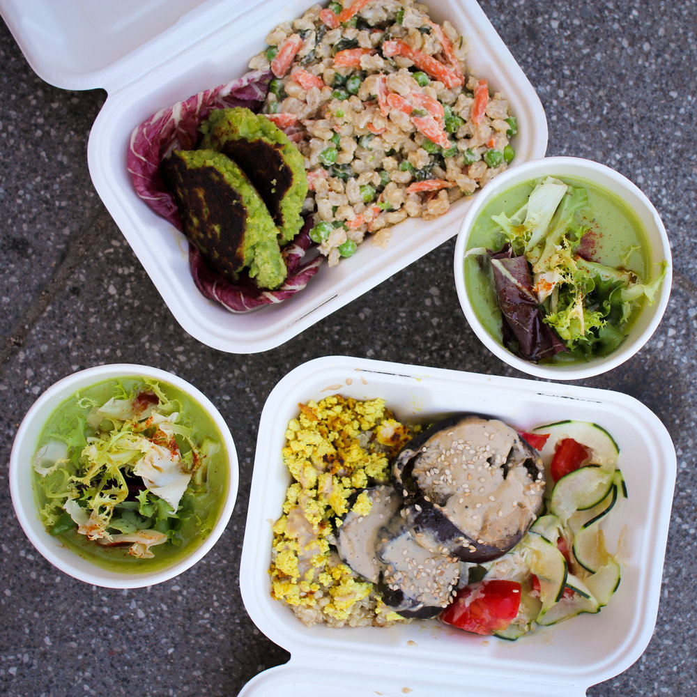 two Bio Bento lunches: creamy avocado soup starters, pea fritters and a bulgur wheat vegetable salad, and miso flavoured aubergines with scrambled tofu and cucumber