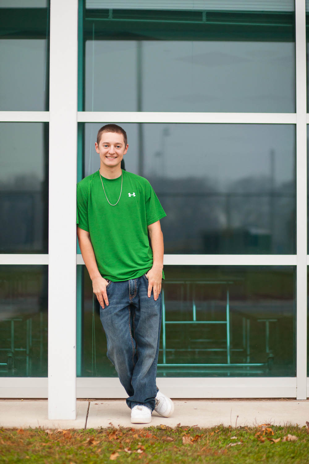 Erin Wood Photography Central CT senior photographer senior boy in front of windows
