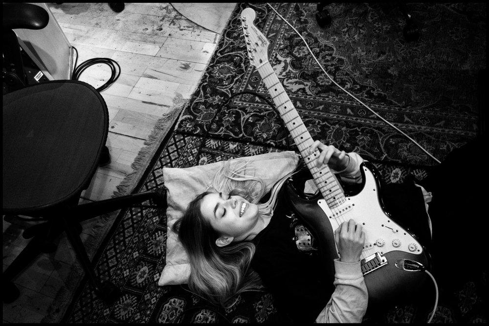 L Devine in the recording studio.