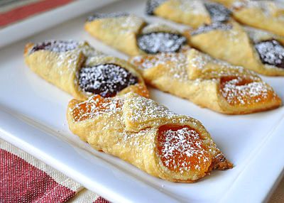 Delightful Desserts! - Kolacky (or Kolache) is a type of Polish pastry that holds a dollop of fruit rimmed by a puffy pillow of supple dough. Originating as a semisweet wedding dessert from Central Europe, they have become popular in parts of the United States.