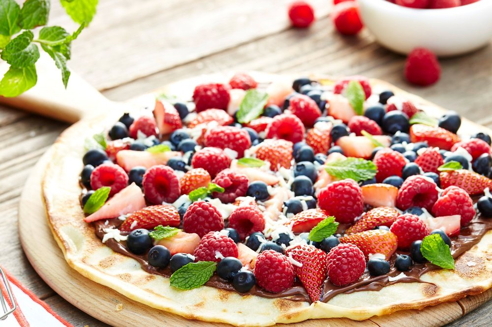 Delightful Desserts! - This dessert fruit pizza is the best of two worlds. It's got major health aspects as it uses a host of delicious and vitamin rich fruits while adding in that always decadent flavor of chocolate. As with all desserts, if eaten in moderation (1 slice not 6!!), there's nothing wrong with going the treat route! Enjoy!