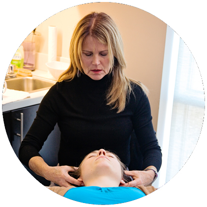 Madelon Hassberger, LMT, CST during a CranioSacral Therapy session.
