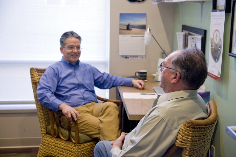 Dr. Dave Johnson working with patient during a health coaching session.