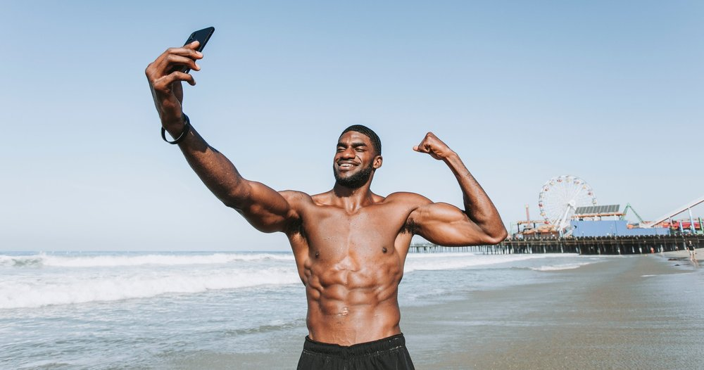 athlete-beach-biceps-1437864.jpg