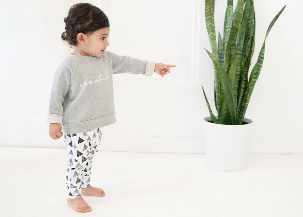 Petunia and Buster - I was first introduced to Petunia and Buster when Q got a pair of their harem pants for his 1st birthday from one of my closest friends. Local brand from Vancouver, B.C., their patterns are unique and fun and easy to wear.  The most recent SS17 collection has by far the most lively patterns, including flamingos, anchors, sharks, waves and palm leaves.  Easily paired with with a basic solid tee or tank and you're set for summer.  Can't wait see what they come out with for the fall.Q is wearing Petunia and Buster's Stone and Steel Harem Leggings.