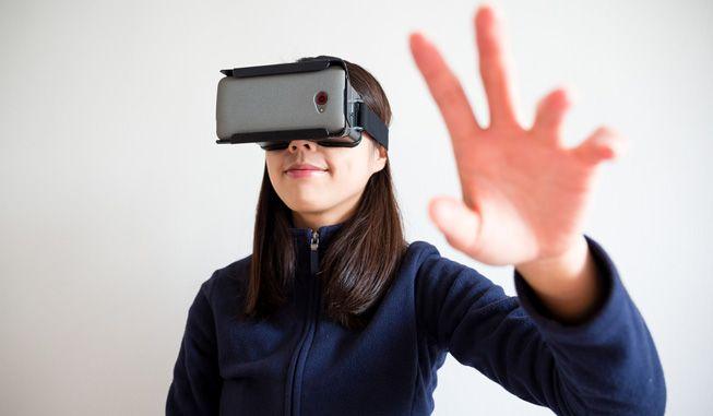 Woman-Uses-Virtual-Reality-Headset.jpg.653x0_q80_crop-smart.jpg