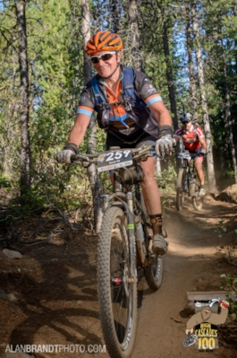 Coach Anne Linton guiding one of her clients in High Cascades 100 MTB Race 2014.