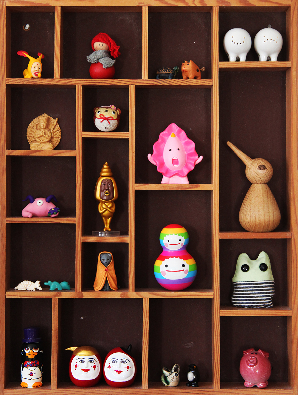 - Knick knack box in David and his husband's home displaying curious objects collected over the years.