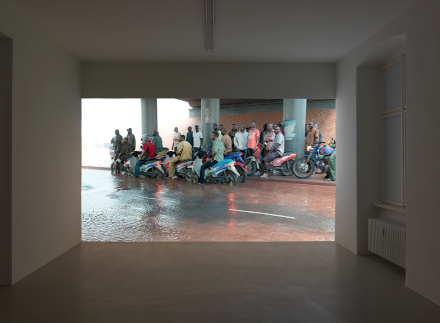 Oil Workers (From the Shell Company of Nigeria) Returning Home From Work, Caught in Torrential Rain , David Claerbout, 2013, single channel video projection, HD animation, colour, silent, endless <http://davidclaerbout.com/filter/work/Oil-workers-from-the-Shell-company-of-Nigeria-returning-home-from> [accessed 4 November 2016]