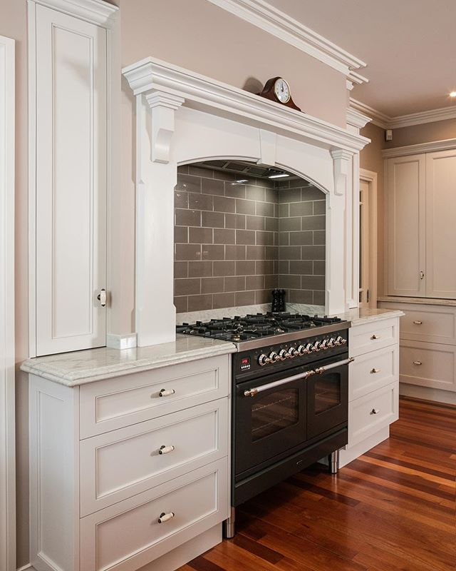 The standout feature of this kitchen is the solid mortise and tenon framed timber doors,  carefully hand painted by the talented team @vision_painting_and_design ~ Bench tops are white Macaubas Quartzite. ~ 📸 shot by @mojophotography