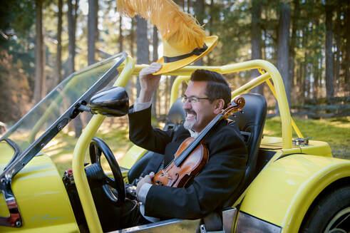 calvin-in-yellow-car-2.jpg