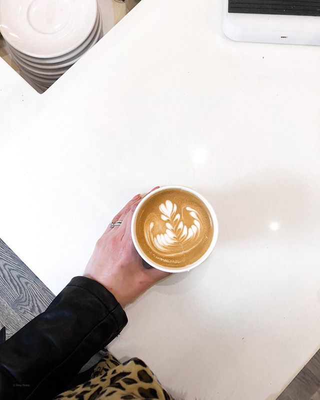 Good morning! ☀️ View from where I'm standing; this latte almost makes up for the dreary weather. ☕️ Jw - How do you take your coffee? I keep my drink basic - black coffee and no sugar in my lattes.  Boring yes, but I'm saving a few calories! 😂 . . . . #latteart #coffeeplease #viewoftheday #instayum #eats #forkyeah #saturdaymorning #foodie #drinkthis #bostonblogger #thenines