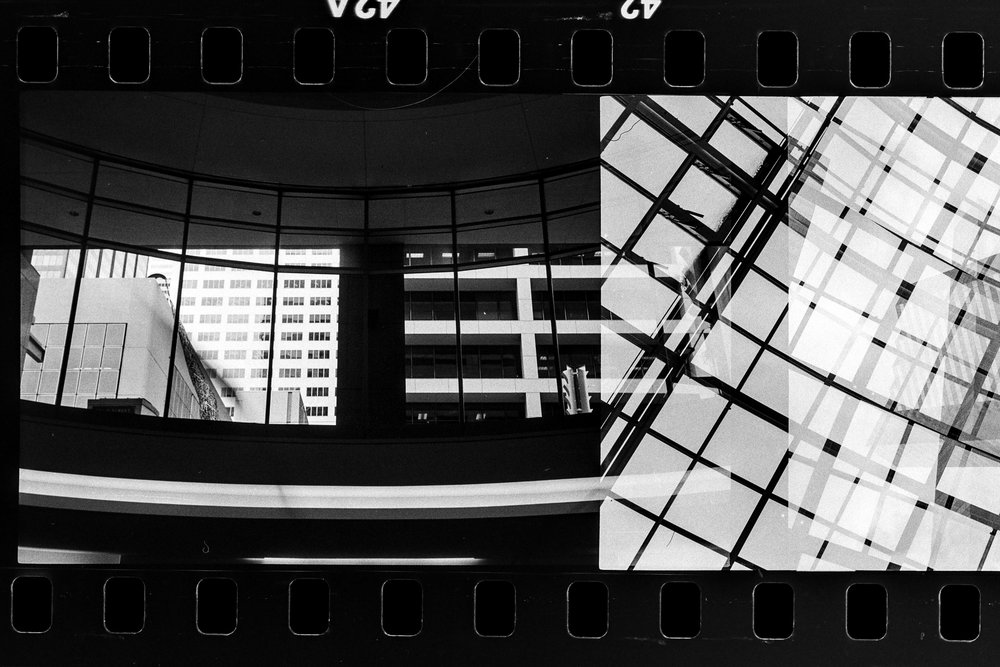 Overlapping 35mm frames. Pictures of downtown Houston from the tunnels. Rollei 35s, Ilford HP5.