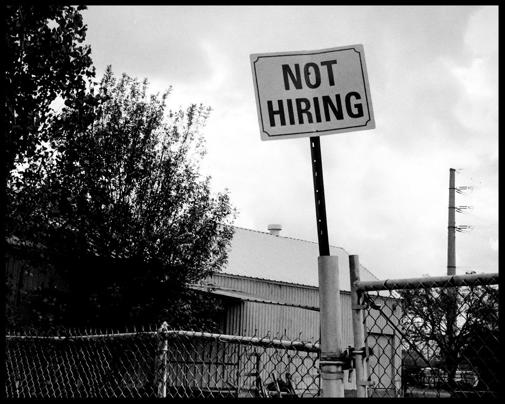 """Not Hiring"", near downtown Houston, Rollei 35, Ilford HP5"
