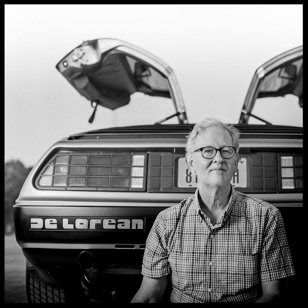 Dennis next to his DeLorean in Houston