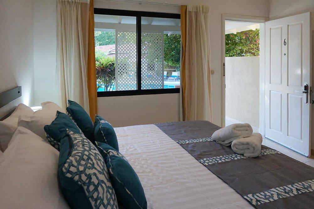 King-bed-with-open-window-and-door_web.jpg