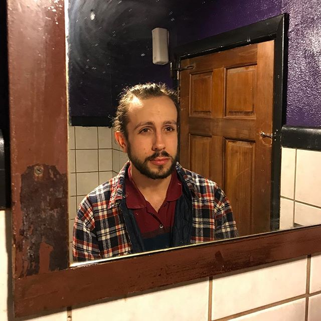 Me, staring at you, staring at me, through your phone, in a mirror, looking at me, staring back at you, in a bathroom.