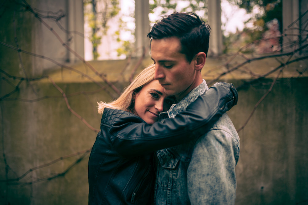 A Natural style portrait of the couple having a moment together in the grounds of St Dunstan-in-the-East