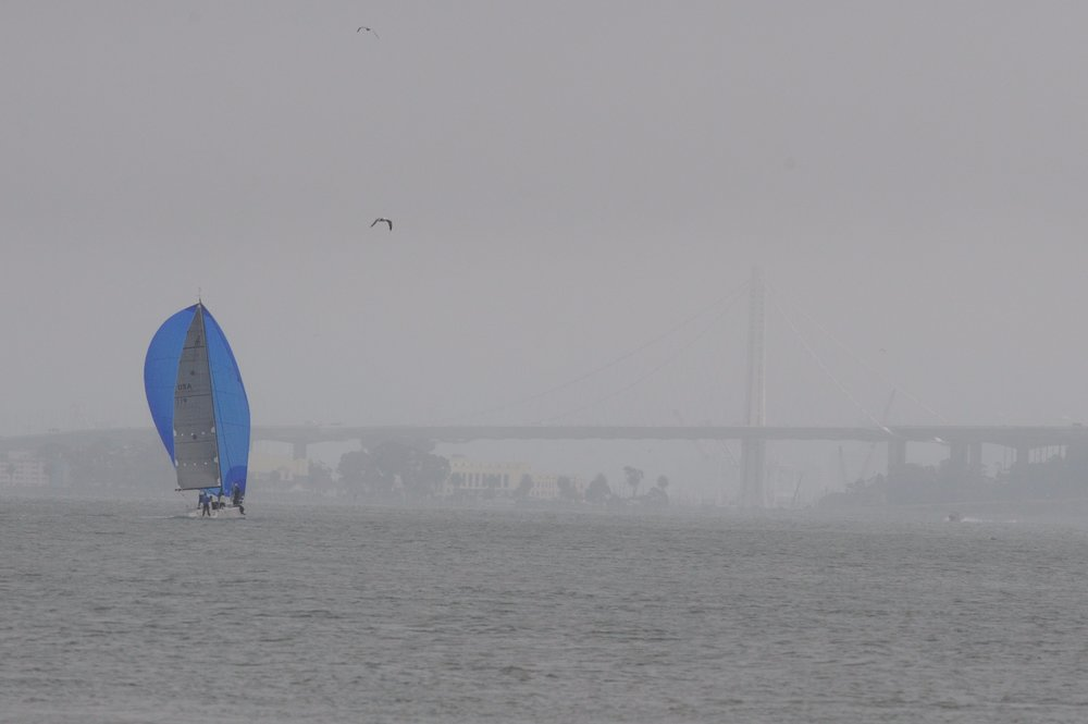 Sailboat headed towards the Bay Bridge.