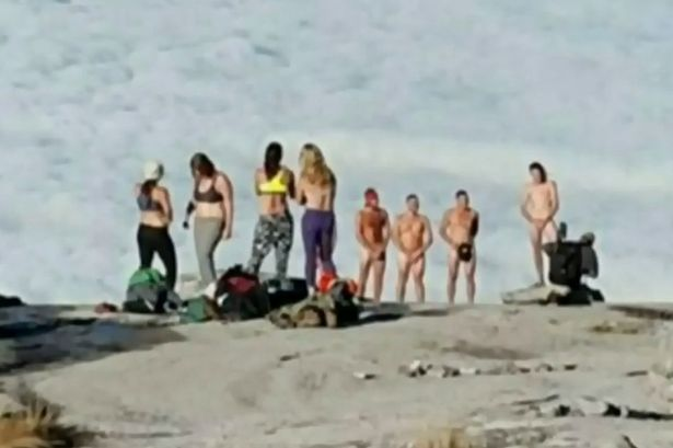 SAUNDRA: Naked backpackers caught pics