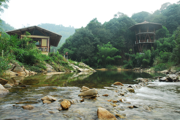 Crosswaters Ecolodge in China exemplifies the use of sustainable building materials such as locally harvested bamboo. Here, an observation tower and a fine dining restaurant are located where two rivers meet.