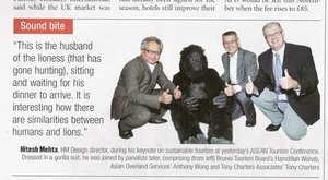 The medium is the message, as Hitesh dons a gorilla suit to communicate the need for rainforest conservation.
