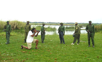 Hitesh, protected by armed guards, during his work in Congo.