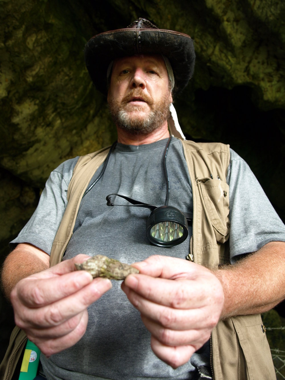 James holding a sea shell found in a cave.