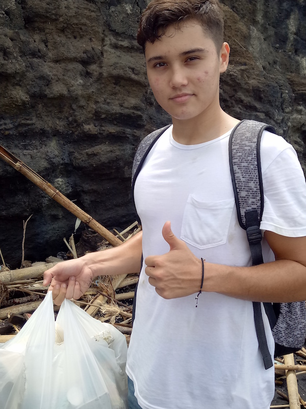 Ransome hauling bags of washed up rubbish at the end of his first shift.