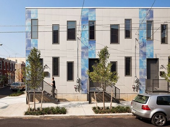 "Postgreen Homes' ""Skinny Project"" consists of 3 LEED Platinum Homes that can be built on lots as narrow as 13 feet, but which developers say still has an open and roomy feel. Photo credit: Postgreen Homes."