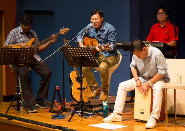 MEM alumnus Nelson Lo (second from left) and friends entertain the audience with environmental songs at MEM Alumni's Circular Economy Seminar.