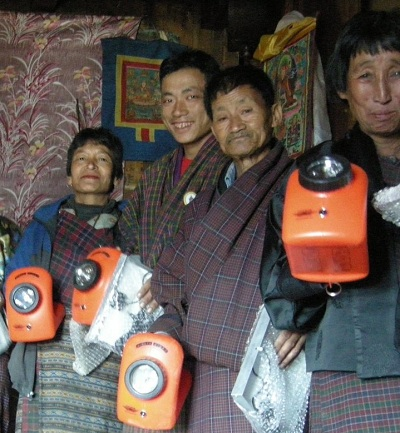 Villagers in Bhutan show off their LED lights. Courtesy Folkways Institute.