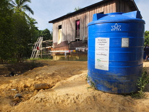One of the water tanks in Mandamai village was not installed to their house