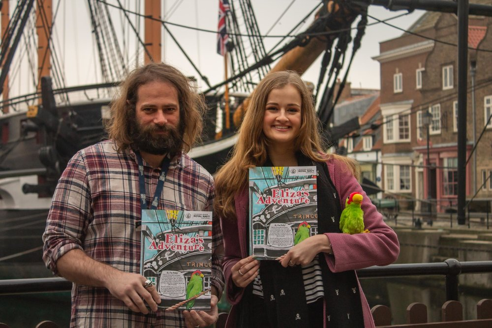 """Richard Davidson (Illustrator and Learning Producer at the NMRN) with Abby Taylor, pictured with trail guide they produced, """"Eliza's Adventure""""."""