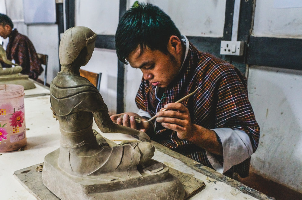 Kuenga - The clay statue maker