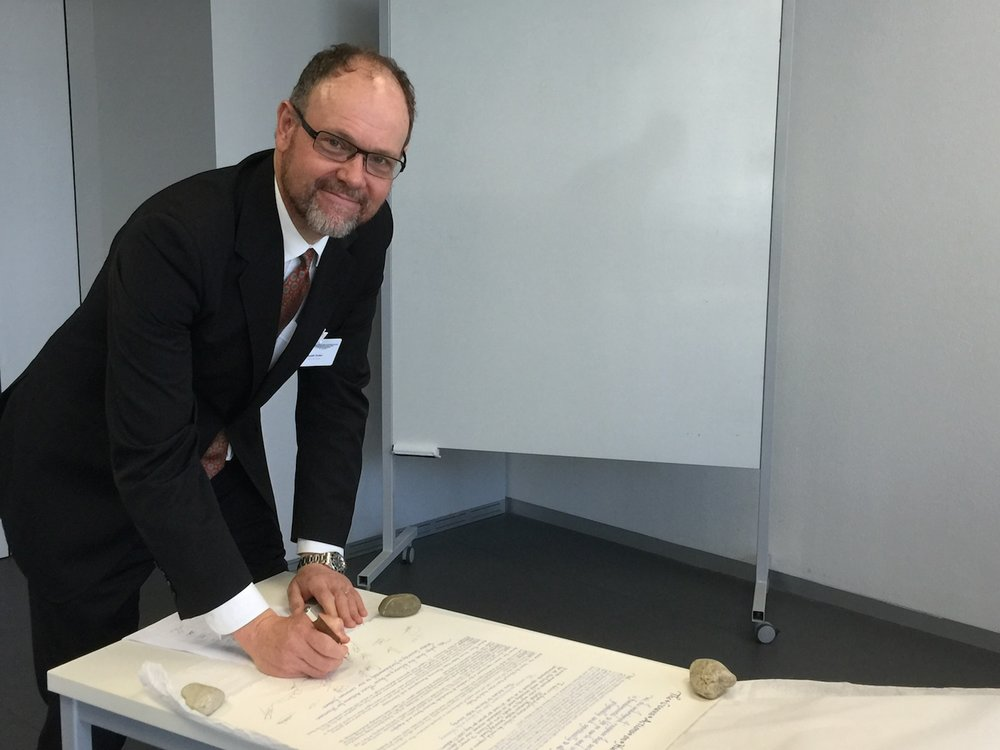 Professor Quentin Grafton signs The Geneva Actions on Human Water Security in Geneva, Switzerland, on 7 July