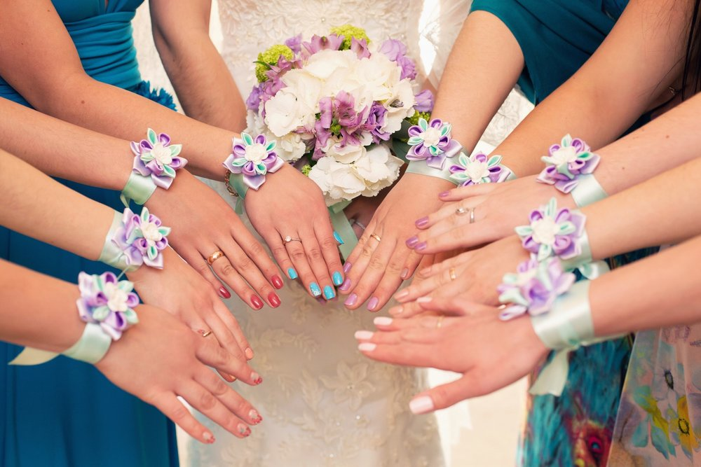 Beautiful wrist corsages... - in matching ribbon colours will tie in your theme wonderfully and will delight bridesmaids and flower girls alike!