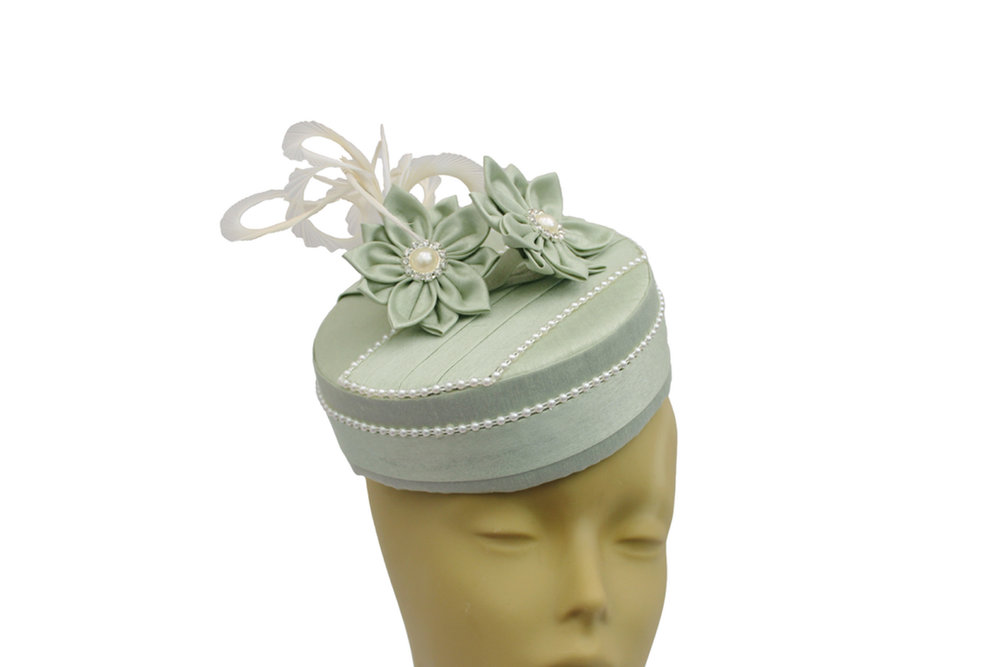 pale green pillbox with flowers.jpg