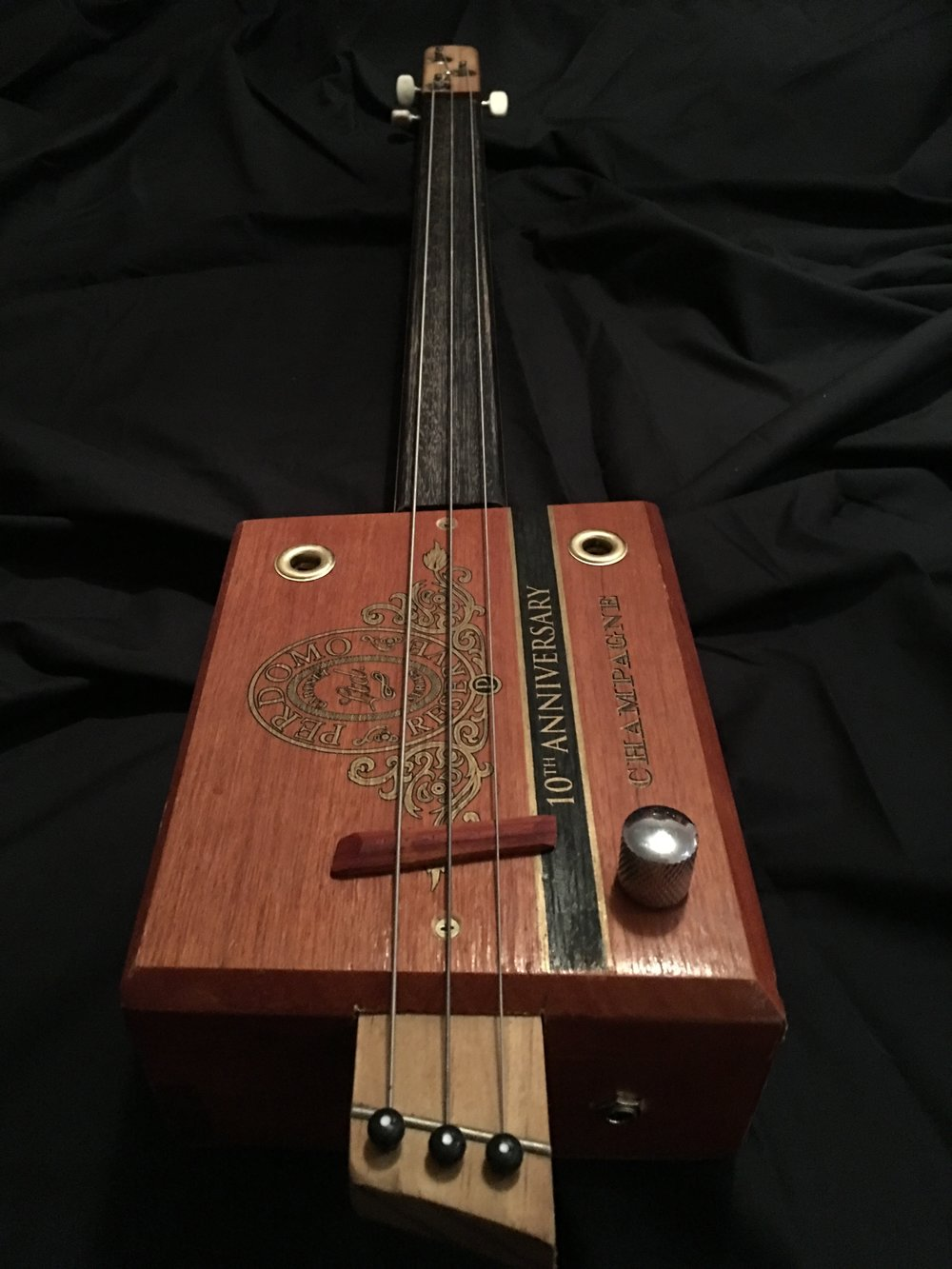 HURRICANE fretless CBG - A basic CBG doesn't need to be poorly constructed. Our HURRICANE CBG range is designed to be played at home or in front of an audience. We use an acoustic piezo pickup to amplify the acoustic properties of the guitar. As this guitar doesn't have frets you will need a finger slide.* genuine cigar boxes* timber necks with meranti finger boards* neck dot position markers* quality tuners* tuned GDg* industry standard electrics* decorative corner protectorsFrom $189