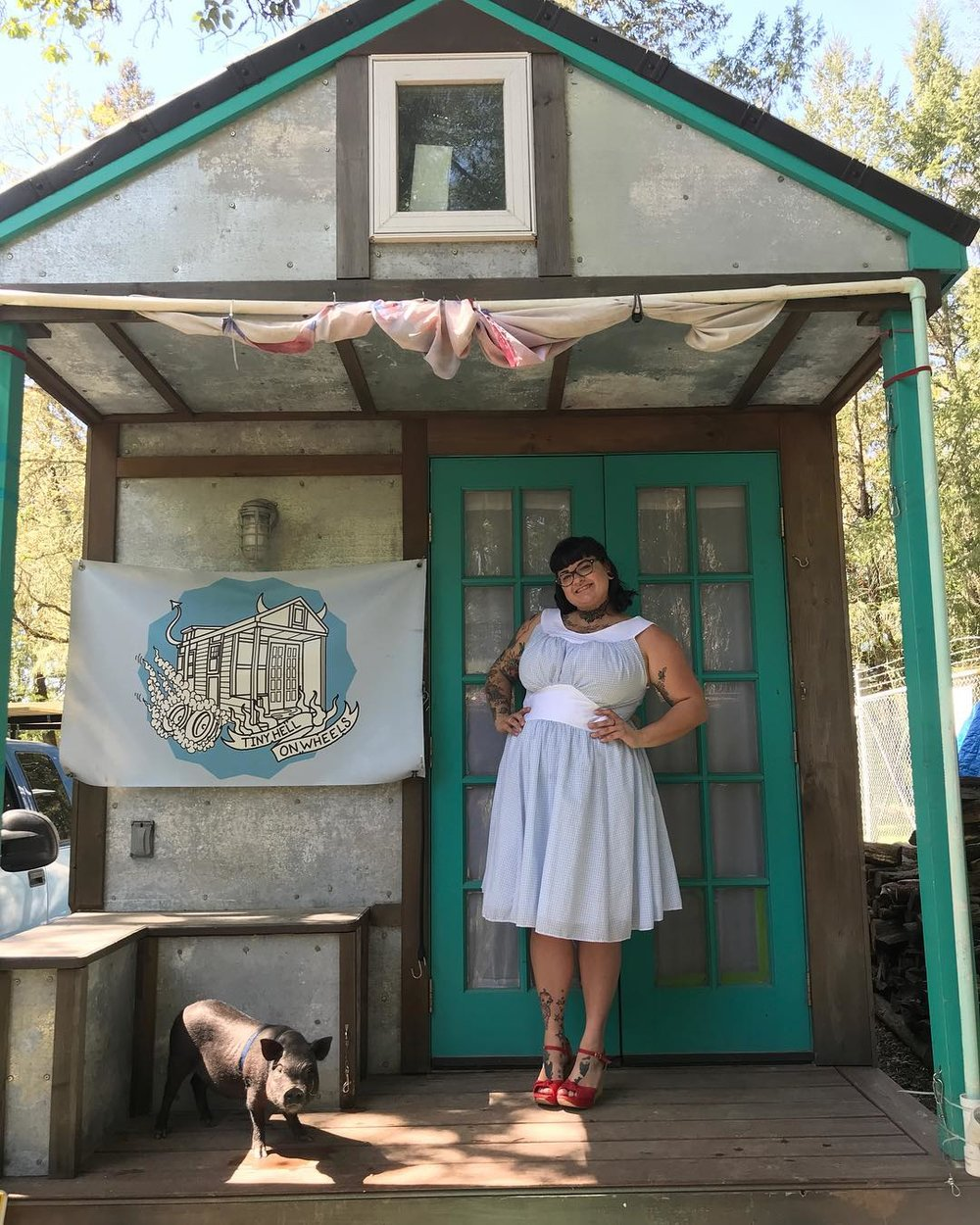 Hilarie Tamar & Crusher the Mini Pig - She built her house in 3 years and traveled 15,000 miles across the USA & Canada. Tiny Hell on Wheels is Hilarie's self built tiny house. She started her build in September of 2014. It took her almost three years of on and off building, of saving money, of healing from illnesses, of losing family members and of immense self growth to finally move into her tiny dream house. Her dream was to move out of her mom's house but she didn't want to throw money in the toilet by renting an overpriced and unkempt NJ apartment. Instead, her mom, Kandi, let her daughter build in the backyard. Three years later she hit the road, traveling over 15,000 miles in the first year and meeting people that would change her life forever. She is currently parked in a small North Bay Area town in California.