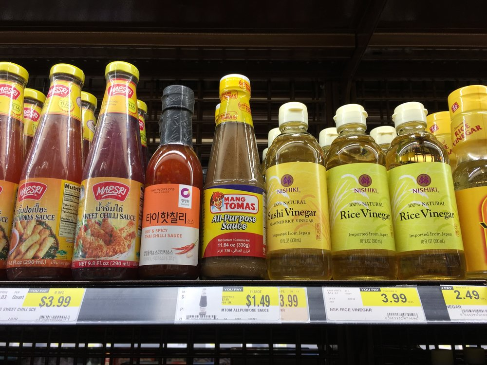 H-mart condiment shelf - Mang Tomas All Purpose Sauce is used for lechon (pork dish), and I suppose other purposes as well... (c) Christina Yung