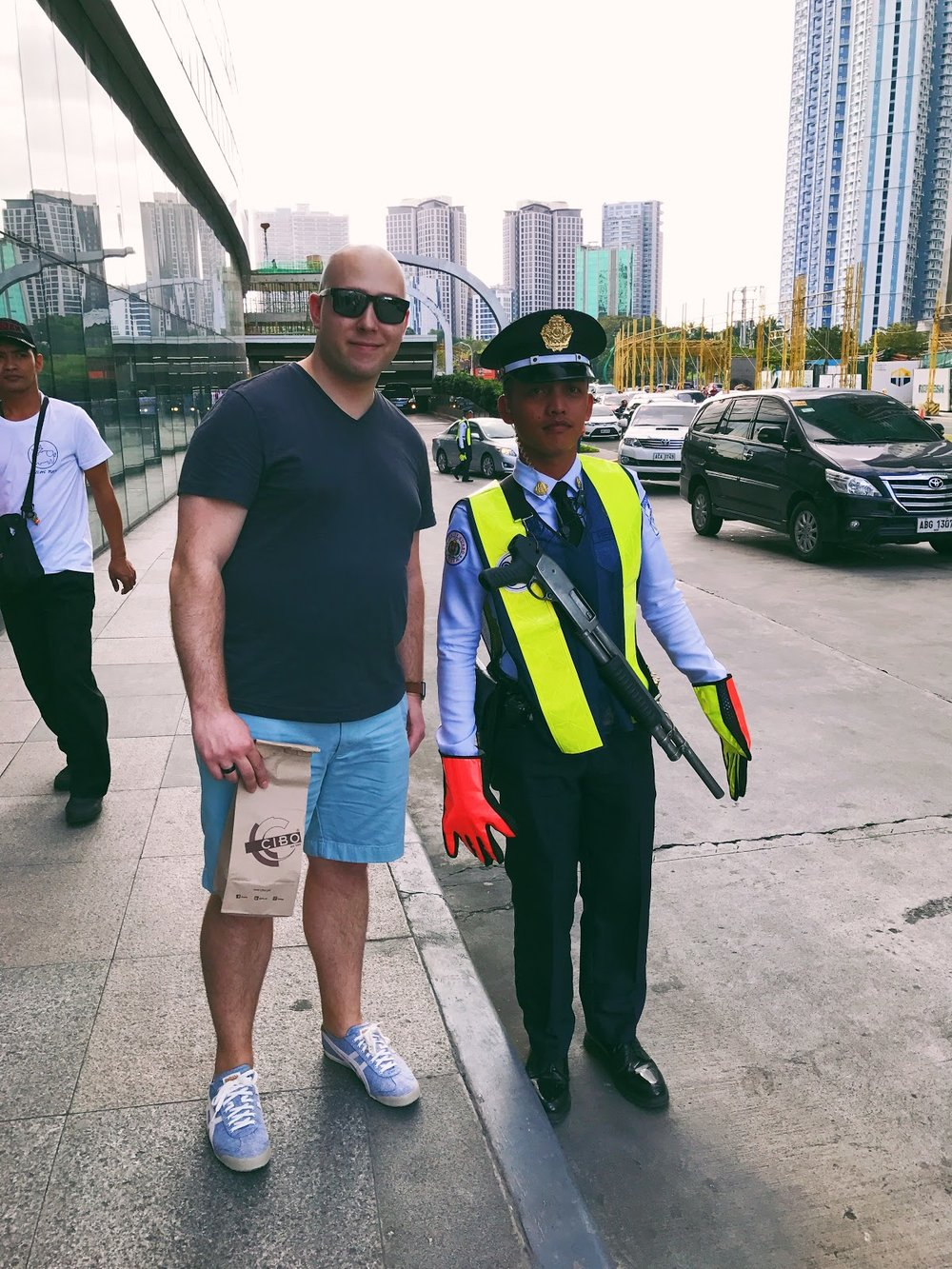 Here's a picture of me (*not Vin Diesel) with the SM Aura mall security guard carrying a rifle.