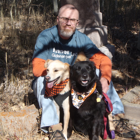 Yes, this is a shot of me and my dogs in a graveyard. In my spare time, I write horror and sci-fi stories, and I'm a member of the Horror Writers Association, the only organization in which you'll find my name in the same directory as Stephen King.