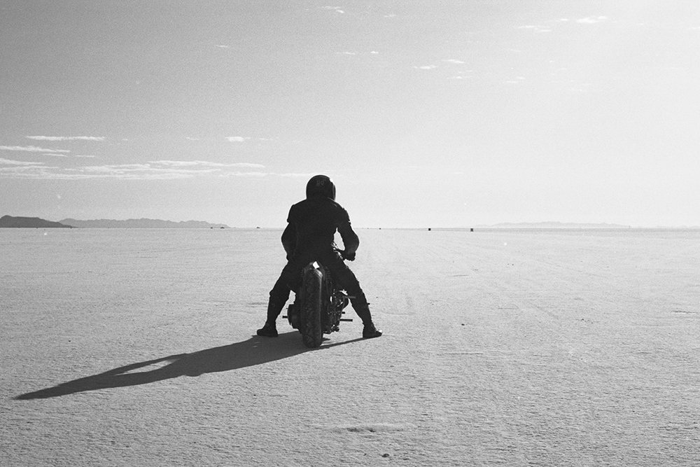 An image of a motorcycle at Bonneville Salt Flats taken from the Greasy Hands Preachers documentary
