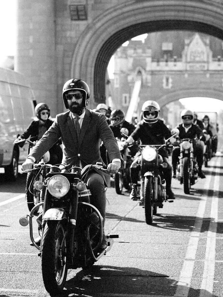Andrew Almond riding a motorcycle as part of the Gentleman's Ride.